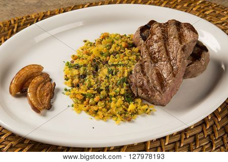 Fillet Mignon Grilled On Plate With Crumbs And Bacon