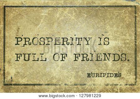 Prosperity is full of friends - ancient Greek philosopher Euripides quote printed on grunge vintage cardboard
