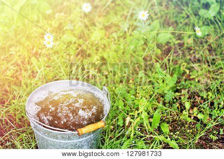 Full bucket of rainwater of the summer
