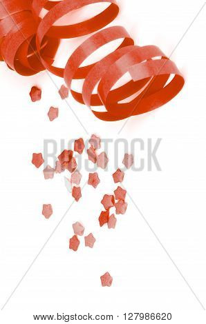 Curled Red Party Streamers and Star Shape Confetti isolated on White background