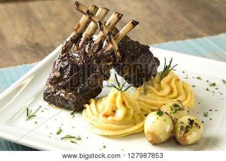 A Delicious Dish Of Rack Of Lamb With Potato.