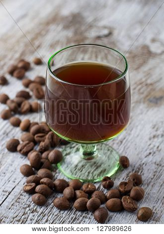 Glass Of Coffee Liquor And Coffee Beans