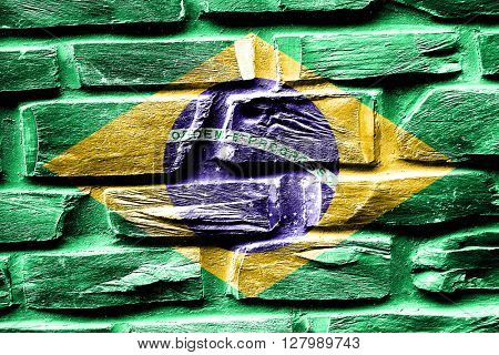 Brick wall Brasil flag with some cracks and vintage look