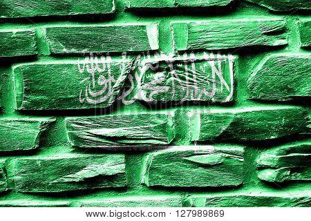 Brick wall Saudi Arabia flag with some cracks and vintage look