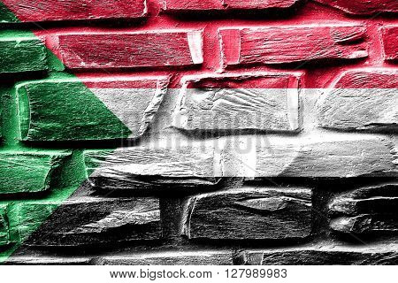 Brick wall Sudan flag with some cracks and vintage look