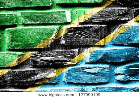 Brick wall Tanzanian flag with some cracks and vintage look