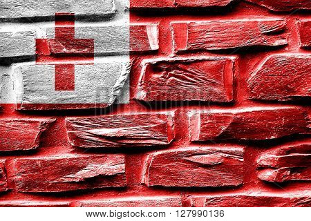 Brick wall Tonga flag with some cracks and vintage look