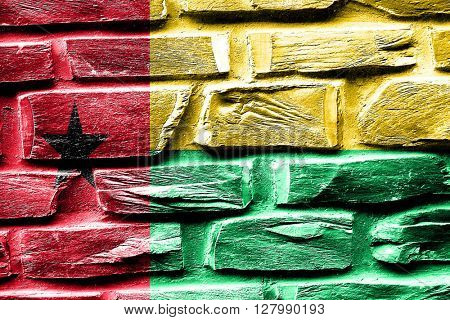 Brick wall Guinea bissau flag with some cracks and vintage look