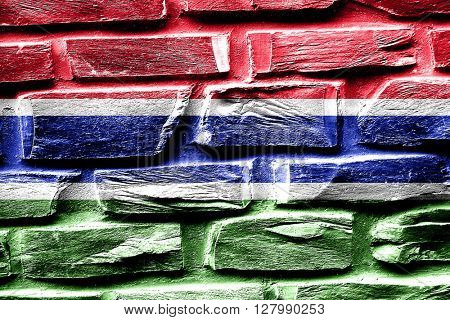 Brick wall Gambia flag with some cracks and vintage look