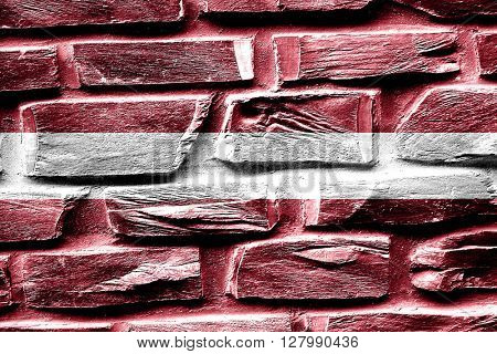 Brick wall Latvia flag with some cracks and vintage look