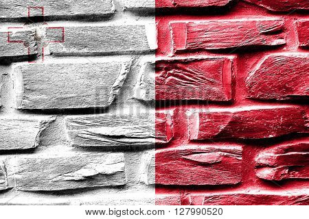 Brick wall Malta flag with some cracks and vintage look