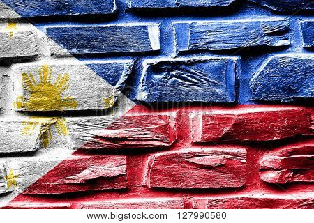 Brick wall Philippines flag with some cracks and vintage look