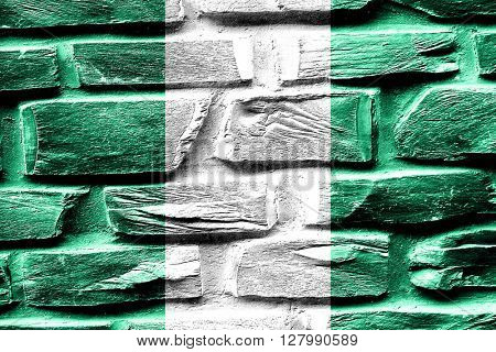 Brick wall Nigeria flag with some cracks and vintage look