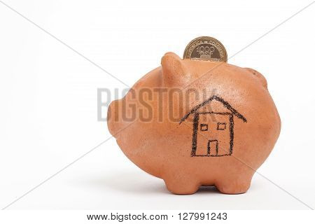 Saving colombian money for a new house -  side view