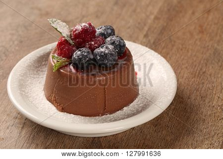 Chocolate mousse with red fruits. Gourmet dessert.