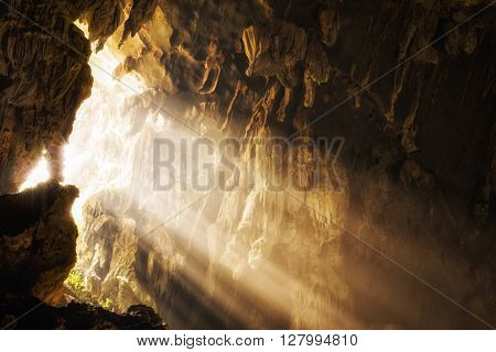 Light shinning through cave opening at Tham Phu Kham cave in Vang Vieng, Vientiane Province, Laos.