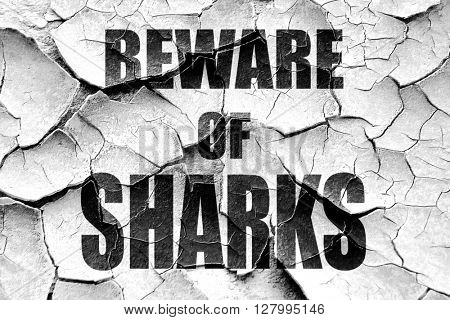 Grunge cracked Beware of sharks sign