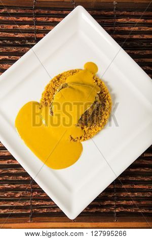 Grilled fish with manioc flour. Wood background.