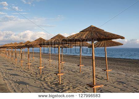 Sunshades at sunset on the beach at Gerani Crete