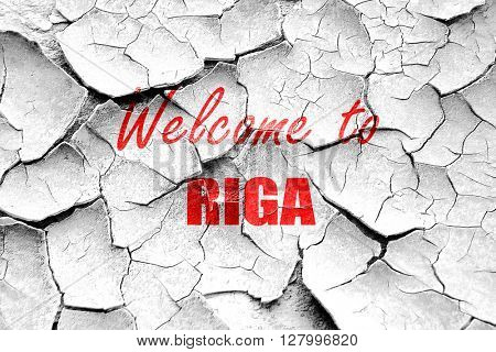 Grunge cracked Welcome to riga