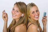pic of beautiful young woman  - two beautiful young women listening to their mp3 players - JPG