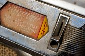 pic of jukebox  - A vintage weathered jukebox coin input close up - JPG