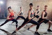 Group of healthy people on group training with resistance band poster