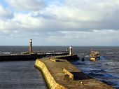 picture of safe haven  - whitby harbour on a bright winter day.