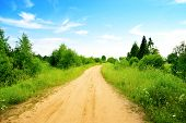 picture of dirt road  - road from sand and perfect summer day - JPG