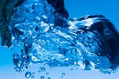 the blue water splash as abstract background