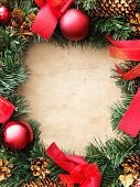 stock photo of christmas wreath  - Christmas wreath on the paper - JPG