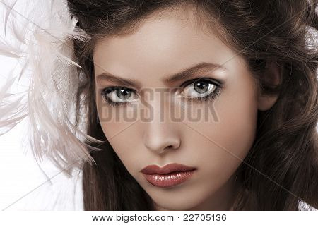 Portrait Of A Pretty Girl With Big Grey Eyes And Feather Accessory