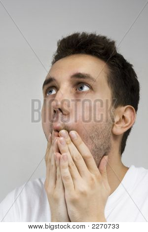 Young Man With Hands On Face Feeling Desperate