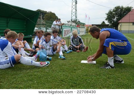 NAGYBERKI, HUNGARY - JULY 18: Ukrainian players listen to their trainer at the VII. Youth Football Festival Under 14 match Kiev (UKR) vs. Brescia Academy (ITA) July 18, 2011 in Nagyberki, Hungary