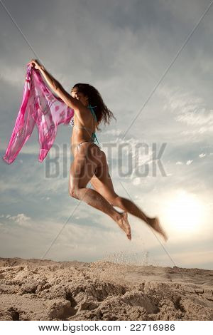 Young Brunette Woman At The Beach Enjoying Herself