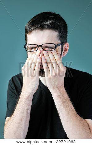 Man Rubbing Eyes