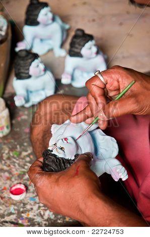 Artist Painting Idols