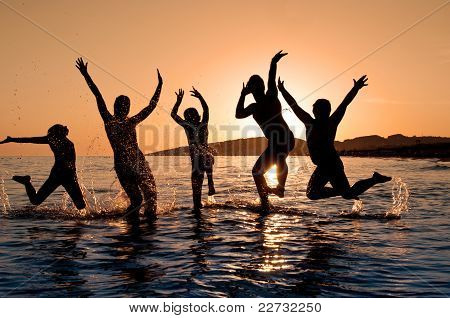 Silhouette Of Family Jumping
