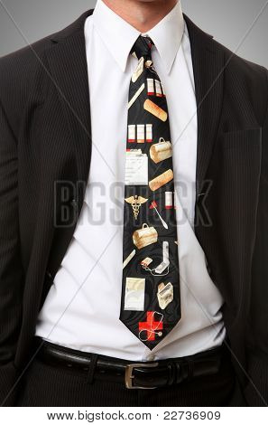 A well dressed doctor with a medical themed tie