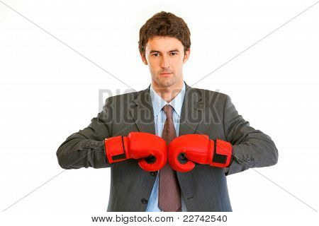 Authoritative Modern Businessman With Boxing Gloves
