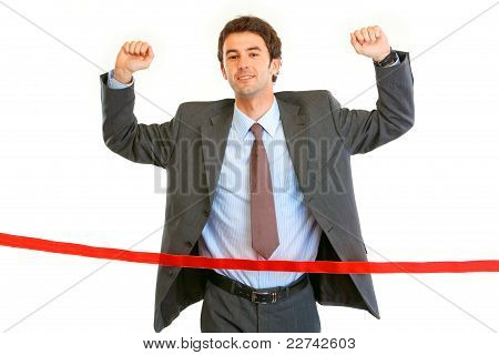 Pleased Businessman  Crossing Finish Line. Concept - Success Achievement