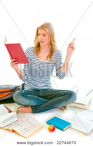 Pensive Teenager Sitting On Floor Among Schoolbooks And Studying