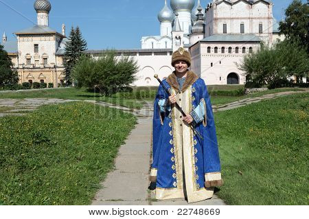 Man In Regal Clothes With Staff