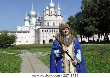 Tourist In Regal Clothes With Staff