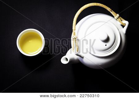 Tea pot and a cup