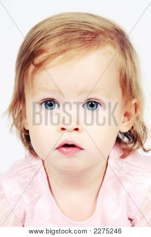 Baby Girl In Dress With Bright Eyes