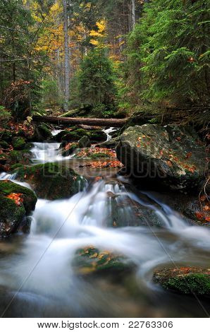 autumn waterfall in the national park Sumava - Czech Republic