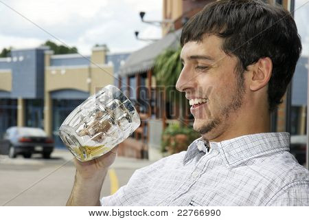 Happy Drinking Young Guy