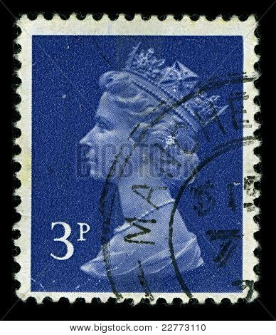 ENGLAND-CIRCA 1971: A stamp printed in England shows image of Elizabeth II (Elizabeth Alexandra Mary, born 21 April 1926) is the constitutional monarch of United Kingdom in blue, circa 1971.