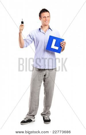 Happy man holding a car key and L plate isolated on white background